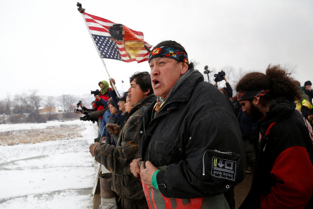 Raymond Kingfisher, 59, of the Northern Cheyenne Tribe, sings during a march on the outskirts of the main opposition camp against the Dakota Access oil pipeline near Cannon Ball, North Dakota, U.S., February 22, 2017. (Photo by Terray Sylvester/Reuters)