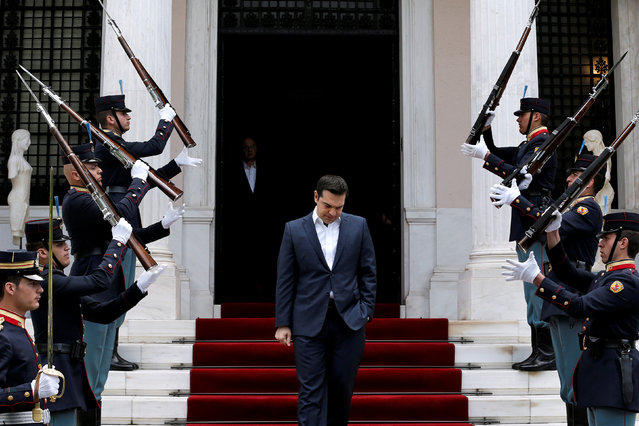 Greek Prime Minister Alexis Tsipras walks down the stairs of the Maximos Mansion as the honour guard presents arms before the arrival of Portugal's Prime Minister Antonio Costa in Athens, Greece April 11, 2016. (Photo by Alkis Konstantinidis/Reuters)