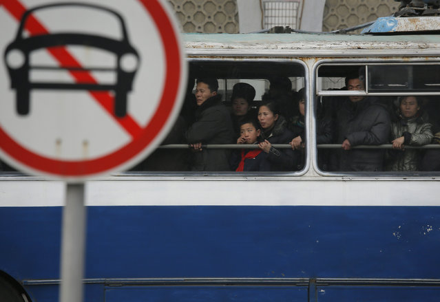 North Koreans look out from a bus on a street in Pyongyang, North Korea, Monday, February 24, 2014. (Photo by Vincent Yu/AP Photo)