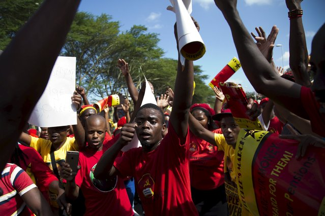 Supporters of the Congress of South African Trade Unions (COSATU) and the South African Communist Party (SACP) lead a march calling for the abolition of labour brokers and the implementation of a national health insurance scheme through Durban, South Africa, April 23, 2016. (Photo by Rogan Ward/Reuters)