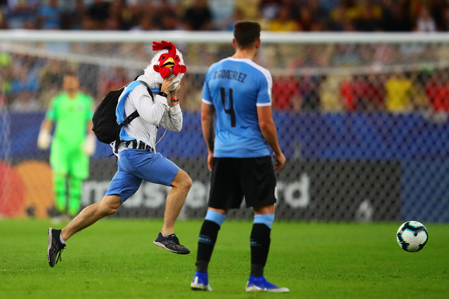 A pitch invader enters the field during the Copa America Brazil 2019 group C match between Chile and Uruguay at Maracana Stadium on June 24, 2019 in Rio de Janeiro, Brazil. (Photo by Chris Brunskill/Fantasista/Getty Images)