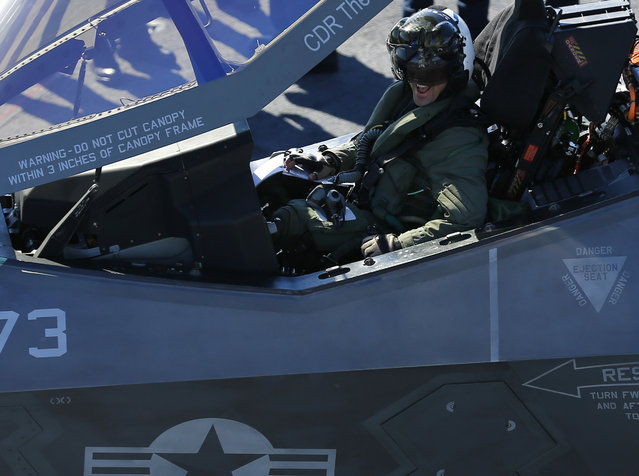 U.S. Navy test Pilot Tony Wilson smiles after making the first ever landing of the F-35C Joint Strike Fighter on the aircraft carrier USS Nimitz using its tailhook system, while off the coast of California, November 3, 2014. (Photo by Mike Blake/Reuters)