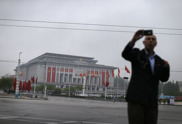 A foreign journalist uses his smartphone to record himself in front of the April 25 House of Culture, the venue for the 7th Congress of the Workers' Party of Korea on Friday, May 6, 2016, in Pyongyang, North Korea. (Photo by Wong Maye-E/AP Photo)
