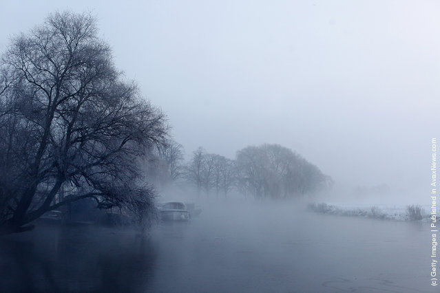 Mist rises from the partially frozen Great Ouse river