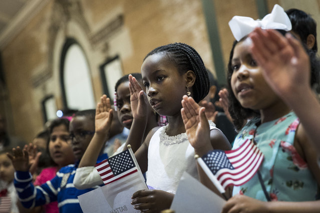 Children take the Oath of Allegiance as they become U.S. citizens during a citizenship ceremony at The Bronx Zoo, May 5, 2017 in The Bronx borough of New York City. 32 children, ranging in age from 5 to 13 years old, attended the ceremony and became U.S. citizens. (Photo by Drew Angerer/Getty Images)