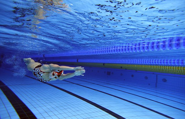 Hungarian swimmer Katinka Hosszu propels herself underwater at a training session in Budapest, Hungary July 15, 2015. Before she became 2014 World Swimmer of the Year and the first to pass the $1 million mark in prize money, Hosszu nearly hung up her goggles, frustrated that she failed to win a medal at the 2012 London Olympics. (Photo by Laszlo Balogh/Reuters)