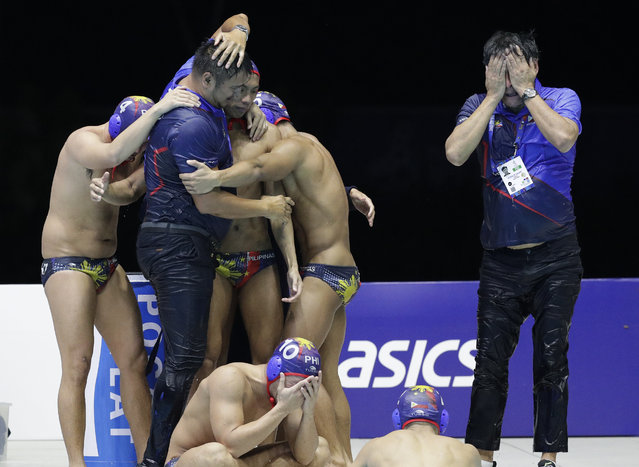 Philippines water polo team react after their game against Singapore at the 30th South East Asian Games in New Clark City, Tarlac province, northern Philippines on Friday, November 29, 2019. Philippines scored a draw against Singapore 6-6. (Photo by Aaron Favila/AP Photo)