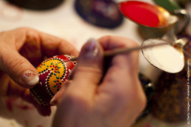 A woman, paints an traditional Lusatian sorbian folk Easter egg in traditional Sorbian motives at the annual Easter egg market