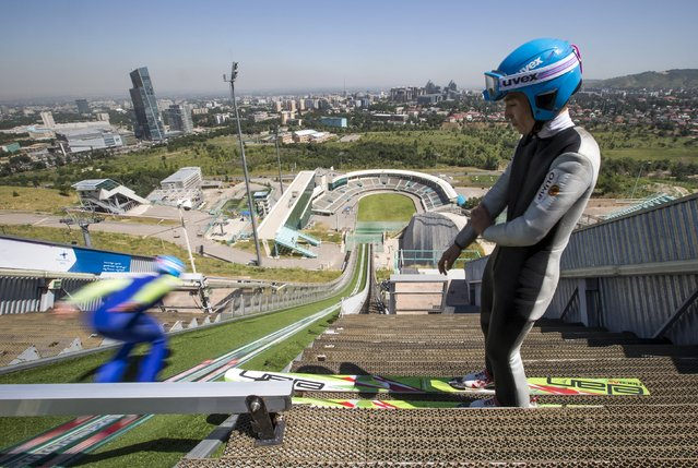 Members of Kazakhstan's national team attend training session at the Sunkar Ski Jumping complex in Almaty, Kazakhstan, July 15, 2015. (Photo by Shamil Zhumatov/Reuters)