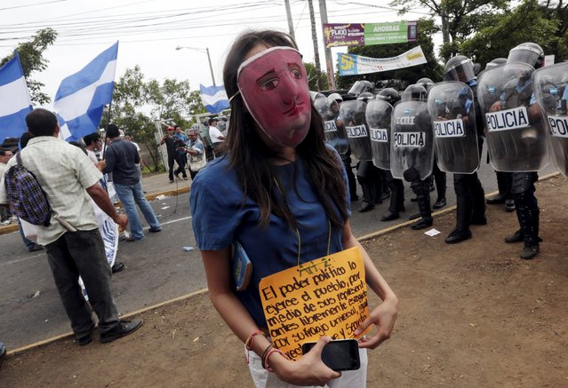 "An opposition supporter takes part in a protest in front of the Supreme Electoral Council (CSE) building in Managua, Nicaragua July 29, 2015. The protesters said they were demonstrating to demand fairer elections in the country next year. The sign reads: ""The political power is exercised by the people, through their representative freely chosen by universal, equal, direct and secret suffrage"". (Photo by Oswaldo Rivas/Reuters)"