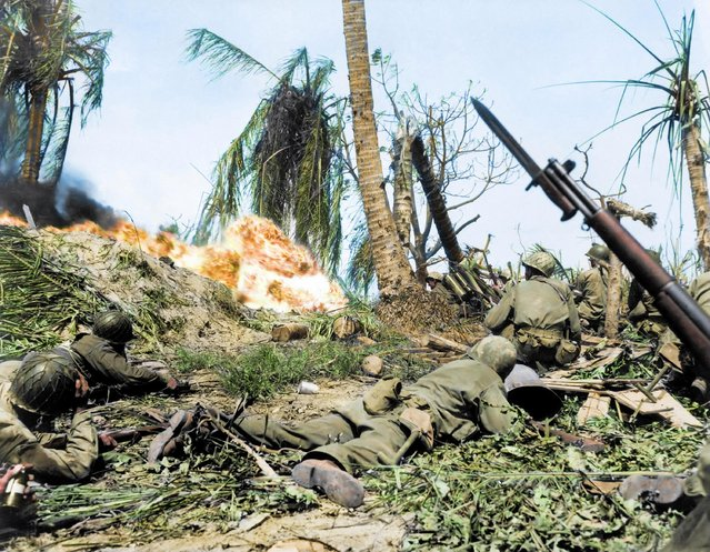 US soldiers of the 7th Infantry Division attacking a Japanese blockhouse on Kwajalein in the Marshall Islands, 1944. The troops began capturing the islands by landing their forces on the beaches. (Photo by Royston Leonard/Mediadrumworld)