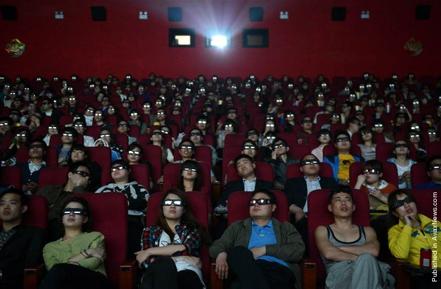 "People wearing 3-D glasses watch the film ""Titanic 3D"" at a movie theater in Taiyuan, China, April 10, 2012"
