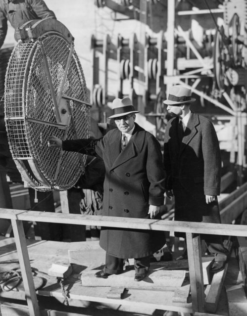 Chief Engineer and builder of the Golden Gate Bridge, Joseph Strauss, and Assistant Chief Engineer William Payne, discuss the details of the bridge as the first string of wire was released and sent out across the space where the bridge will be built, San Francisco, California, 1935. (Photo by Underwood Archives/Getty Images)