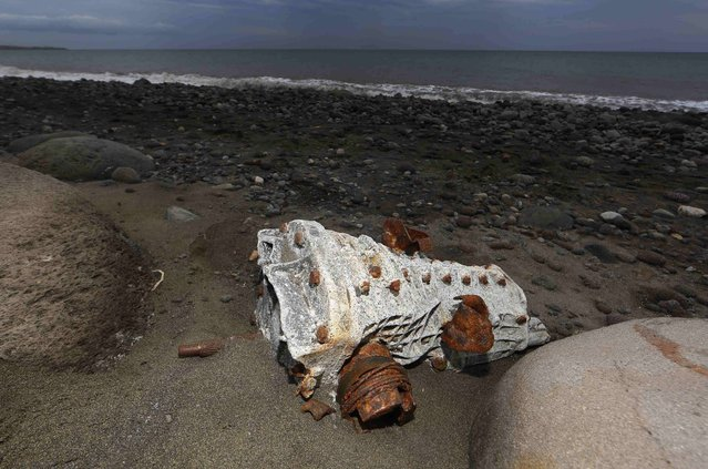 Debris that has washed onto the Jamaique beach in Saint-Denis is seen on the shoreline of French Indian Ocean island of La Reunion, August 3, 2015. (Photo by Jacky Naegelen/Reuters)