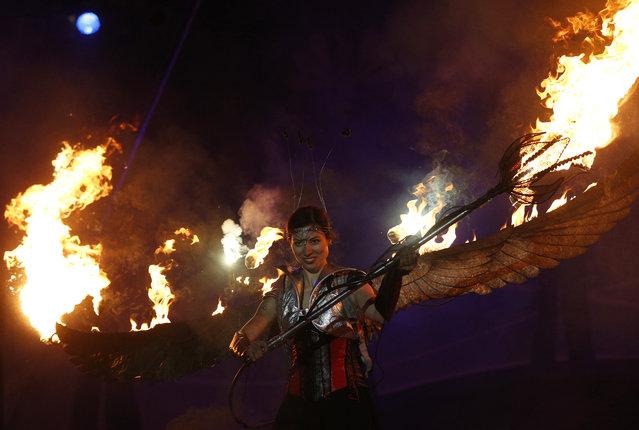 A participant performs during the Kiev Fire Fest in Kiev, Ukraine, Saturday, June 11, 2016. (Photo by Sergei Chuzavkov/AP Photo)