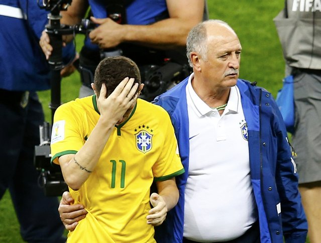 Brazil's coach Luiz Felipe Scolari (R) consoles Oscar after losing their 2014 World Cup semi-finals against Germany at the Mineirao stadium in Belo Horizonte July 8, 2014. (Photo by Leonhard Foeger/Reuters)