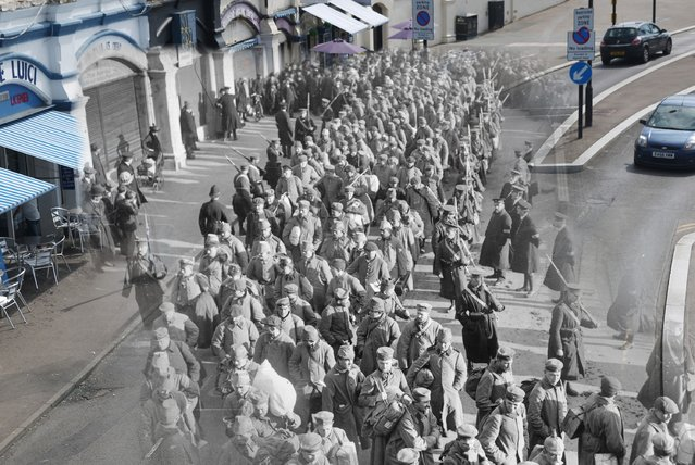 German prisoners of war during the First World War on their way to Southend Pier accompanied by guards and watched by the local populace in 1914, is seen against a backdrop of sunshine on the seafront on July 17, 2014. (Photo by Peter Macdiarmid/Getty Images)