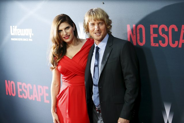 """Cast members Owen Wilson (R) and Lake Bell pose at the premiere of the film """"No Escape"""" in Los Angeles, California August 17, 2015. (Photo by Danny Moloshok/Reuters)"""
