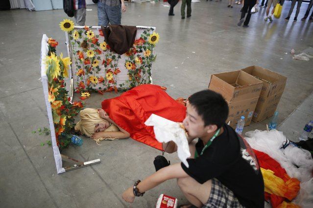 A girl dressed in a cosplay outfit takes a break during the China Digital Entertainment Expo and Conference (ChinaJoy) 2014 in Shanghai July 31, 2014. (Photo by Aly Song/Reuters)