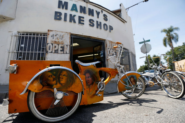 Customized low rider bicycles are pictured outside Manny's bike shop in Compton, California U.S., June 3, 2016. Picture taken June 3, 2016. (Photo by Mario Anzuoni/Reuters)