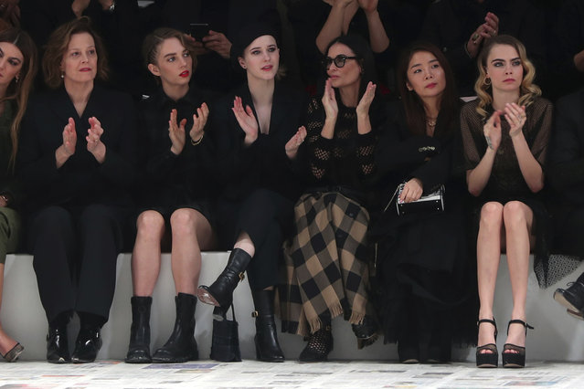From left, Sigourney Weaver, her daughter Charlotte, Rachel Brosnahan, Demi Moore, and Cara Delevingne applause at the end of the Dior fashion collection during Women's fashion week Fall/Winter 2020/21 presented in Paris, Tuesday, February 25, 2020. (Photo by Thibault Camus/AP Photo)