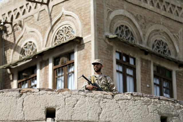 A Houthi militant secures an area where fellow Houthis demonstrated against the Saudi-led air strikes in Yemen's capital Sanaa August 24, 2015. (Photo by Khaled Abdullah/Reuters)