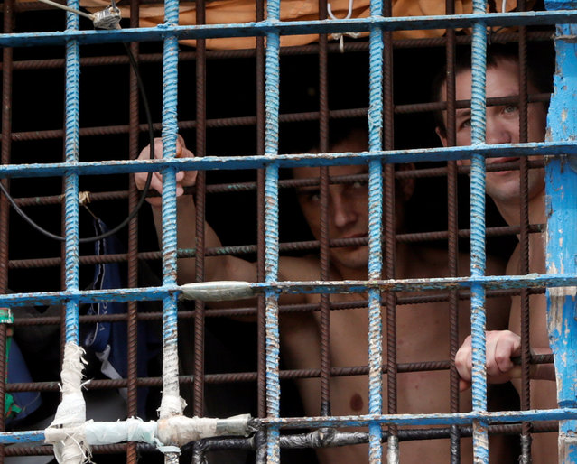 Detainees look out from a prison cell at a compound of the Lukyanivska detention centre in Kiev, Ukraine, July 19, 2016. (Photo by Valentyn Ogirenko/Reuters)