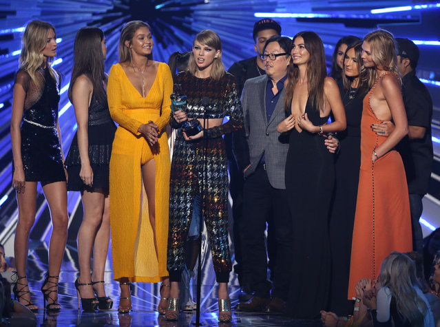 "Taylor Swift, center, accepts the award for video of the year for ""Bad Blood"" at the MTV Video Music Awards at the Microsoft Theater on Sunday, August 30, 2015, in Los Angeles. Pictured from left are, Martha Hunt, Hailee Steinfeld, Gigi Hadid, Joseph Kahn, Lily Aldridge, Mariska Hargitay and Karlie Kloss. (Photo by Matt Sayles/Invision/AP Photo)"