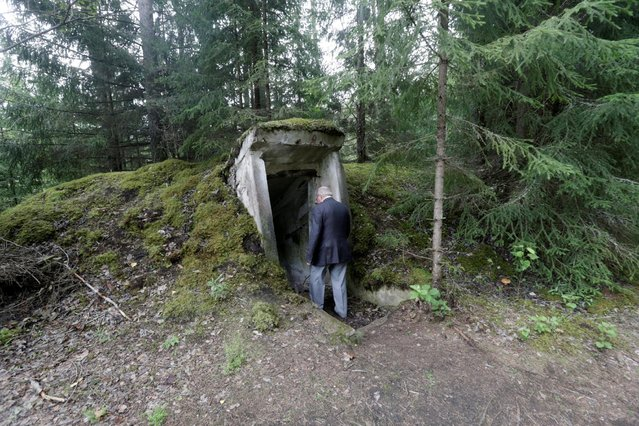 Former Soviet Army officer Leonid Konovalov enters underground bomb shelter at the abandoned former Soviet R12 nuclear missile base in Zeltini, Latvia, July 22, 2016. (Photo by Ints Kalnins/Reuters)