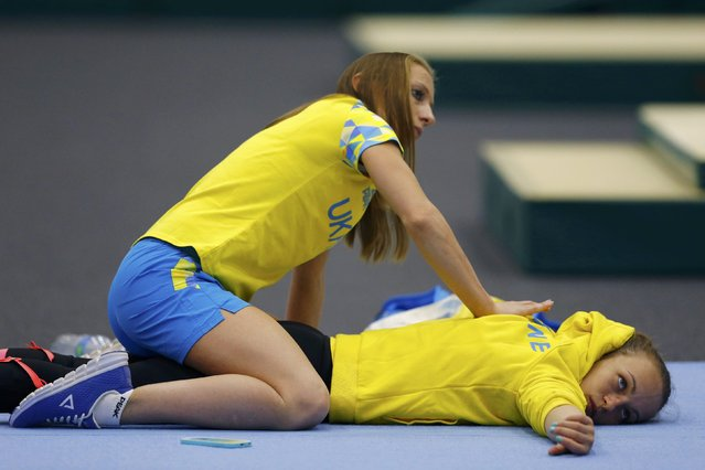 2016 Rio Olympics, Artistic gymnastics, Women's Training, Rio Athletes Park, Rio De Janeiro, Brazil on July 27, 2016. Gymnasts from Ukraine warm up. (Photo by Ivan Alvarado/Reuters)