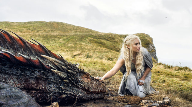 "In this file image released by HBO, Emilia Clarke appears in a scene from ""Game of Thrones"", as the menacing, white-haired Daenerys Targaryen, aka Khaleesi, aka ""Mother of Dragons"". Even in a world with magic, dragons and deadly supernatural White Walkers, HBO's popular show has plenty of economic lessons to teach. (Photo by HBO via AP Photo)"