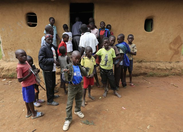 Bukusu boys crowd outside a house in Kenya's western region of Bungoma August 8, 2014. (Photo by Noor Khamis/Reuters)