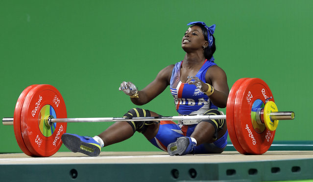 Marina de la Caridad Rodriguez Mitjan, of Cuba, reacts to an unsuccessful attempt in the women's 63kg weightlifting competition at the 2016 Summer Olympics in Rio de Janeiro, Brazil, Tuesday, August 9, 2016. (Photo by Mike Groll/AP Photo)