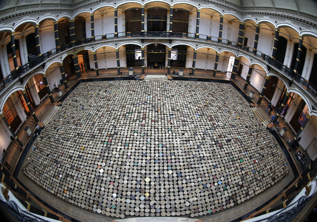 """A general view of the installation """"Stools"""" by Chinese artist Ai Weiwei pictured during a media preview of the """"Evidence"""" exhibition at the Martin-Gropius Bau in Berlin, April 2, 2014. (Photo by Fabrizio Bensch/Reuters)"""