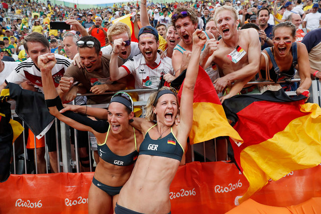 Laura Ludwig (R) and Kira Walkenhorst of Germany celebrate after defeating Larissa Franca Maestrini and Talita Rocha of Brazil during their Rio 2016 Olympic Games Women's Semifinal at the Beach Volleyball Arena on Copacabana Beach in Rio de Janeiro, Brazil, 16 August 2016. (Photo by Orlando Barria/EPA)