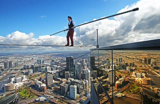 "High-wire artist Kane Petersen successfully walks a tightrope 300 metres above the ground at Eureka Skydeck on September 16, 2015 in Melbourne, Australia. The walk was the highest tightrope walk ever attempted in the Southern Hemisphere. The stunt is to mark the arrival of the film ""The Walk"" to Australian cinemas in October. (Photo by Scott Barbour/Getty Images)"