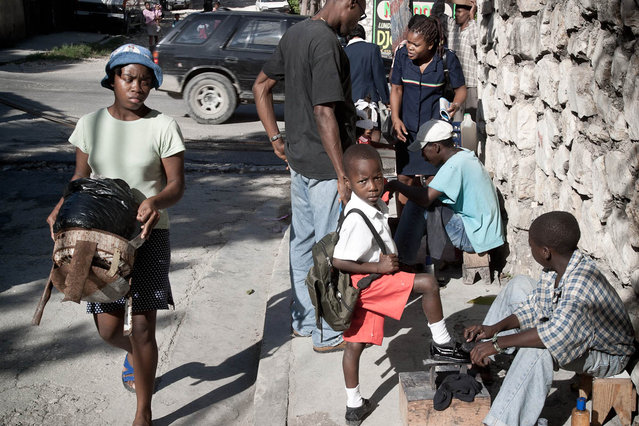 Haiti, Port-Au-Prince. A pupil in the morning in Petion-Ville in November 2003. (Photo by Jean-Claude Coutausse)