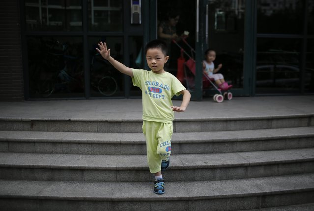 "Only child Ding Zhongcheng, who was born in 2008, poses for a photograph in Shanghai August 30, 2014. ""I don't want to have older brothers or sisters or younger ones either, because I don't want them to mess up all the things in the house. If there was a chance that my mother could give birth to older siblings, then I would accept it"", Zhongcheng said. (Photo by Carlos Barria/Reuters)"