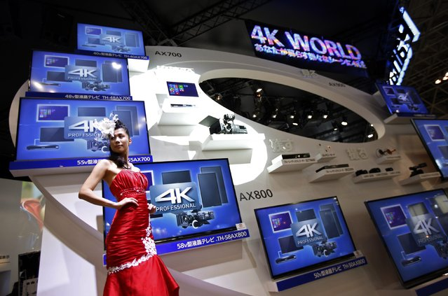 A model presents 4k-capable screens at Panasonic Corp. booth at CEATEC (Combined Exhibition of Advanced Technologies) JAPAN 2014 in Chiba, east of Tokyo, October 7, 2014. Over 500 companies and organisations are exhibiting at CEATEC JAPAN 2014, which will be held until October 11, 2014. (Photo by Issei Kato/Reuters)