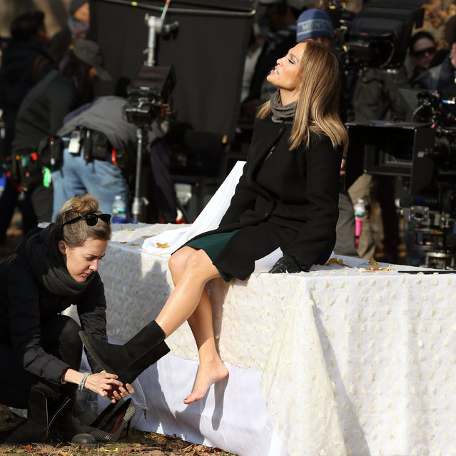 """Actress Jennifer Lopez suntans between takes with bare feet filming """"Second Act"""" in Central Park in New York City, New York on December 4, 2017. Jennifer pitches her """"All in One Ginko Cream"""" product to a business audience seated in the park, included Vanessa Hudgens.. Jennifer chats with actor Treat Williams. (Photo by Christopher Peterson/Splash News and Pictures)"""