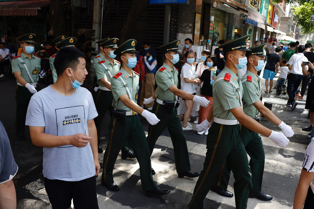 Chinese paramilitary policemen march near the United States Consulate in Chengdu in southwest China's Sichuan province on Sunday, July 26, 2020. China ordered the United States on Friday to close its consulate in the western city of Chengdu, ratcheting up a diplomatic conflict at a time when relations have sunk to their lowest level in decades. (Photo by Ng Han Guan/AP Photo)