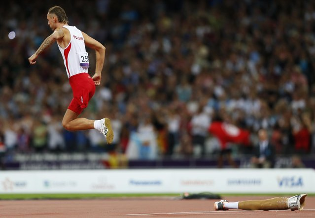 Poland's Lukasz Mamczarz starts his run up during the men's high jump F42 final at the London 2012 Paralympic Games at the Olympic Stadium in London September 3, 2012. (Photo by Andrew Winning/Reuters)