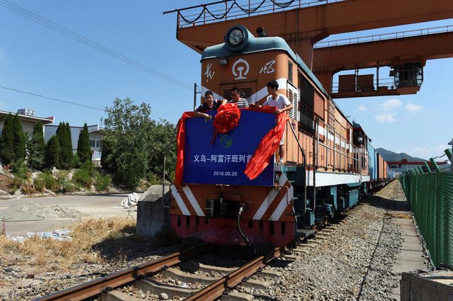 The freight train line from Yiwu, China to Mazar-i-Sharif, Afghanistan starts to operate, August 28, 2016. (Photo by Reuters/Stringer)