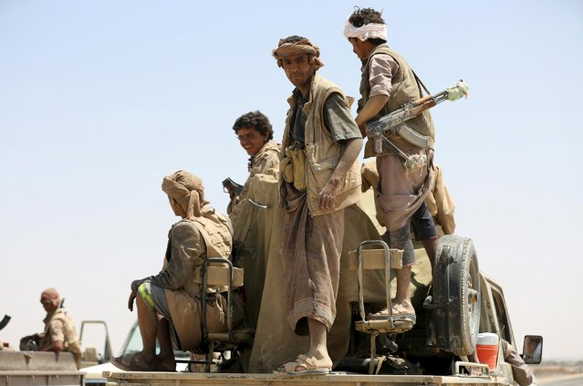 Tribal fighters loyal to Yemen's government ride a truck with their weapons at the frontline of fighting against Houthi militants in the central province of Marib October 8, 2015. (Photo by Reuters/Stringer)