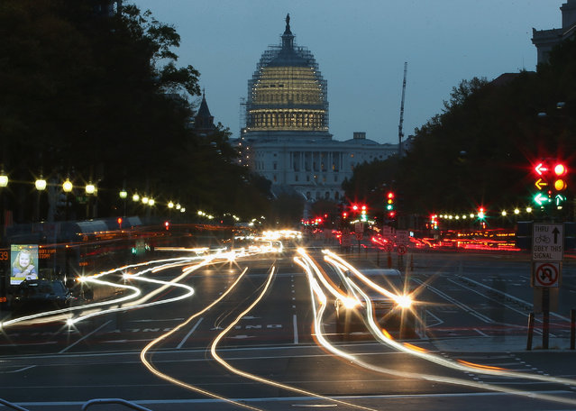 The early morning sun rises behind the US Capitol building as traffic drives down Pennsylvania Ave., November 5, 2014 in Washington, DC. Yesterday Republicans won the majority of the US Senate for the first time in 8 years after Americans went to the polls and voted in the mid-term elections. (Photo by Mark Wilson/Getty Images)