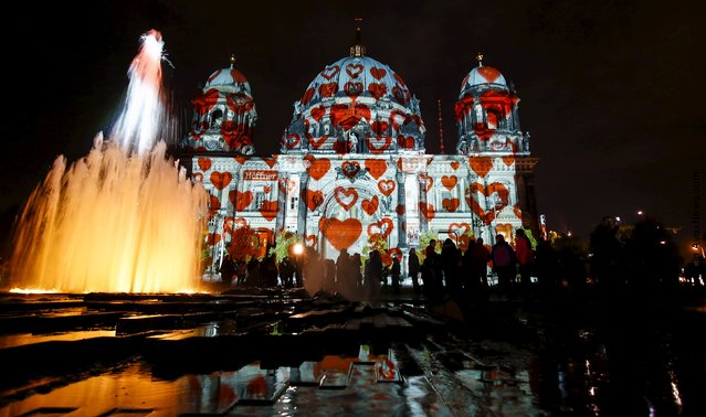 "People look at a light installation at the Berlin Cathedral during the opening day of the ""Festival of Light"" show in Berlin, Germany, October 9, 2015. (Photo by Hannibal Hanschke/Reuters)"