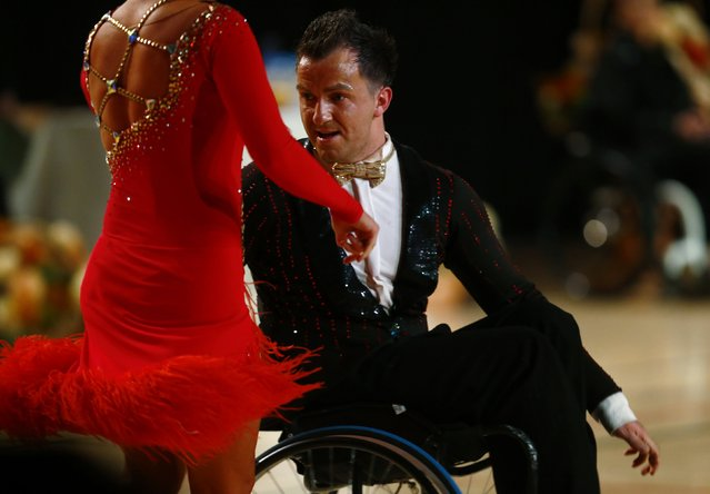 Maksim Sedakov (R) and Svetlana Kukushkina of Russia dance as they compete during IPC Wheelchair Dance Sport European Championships in Lomianki near Warsaw, November 9, 2014. (Photo by Kacper Pempel/Reuters)