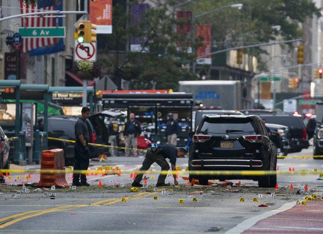 Crime scene investigators work at the scene of Saturday's explosion in Manhattan's Chelsea neighborhood, in New York, Sunday, September 18, 2016. (Photo by Craig Ruttle/AP Photo)