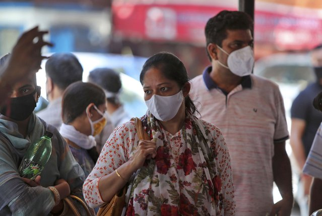 Indians wearing face masks wait for medical check-up outside a government hospital in Jammu, India, Wednesday, September 9, 2020. India's coronavirus cases are now the second-highest in the world and only behind the United States. (Photo by Channi Anand/AP Photo)