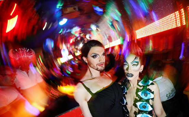 Performers Ryan Stecken and Jacky-Oh Weinhaus pose at Rauschgold bar during an after-show party for drag queens and kings in Berlin, Germany, August 27, 2016. Rauschgold, a colourful and crowded place, is famous for its themed parties. (Photo by Hannibal Hanschke/Reuters)